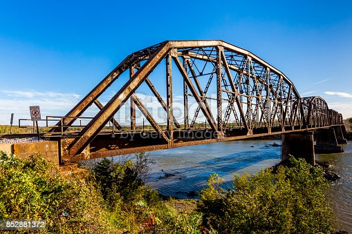 An Iconic Old Metal Truss Railroad Bridge over a Large River.