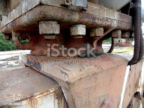 istock Old steel bolts and rusty nuts on a support beam plate. 1213826950