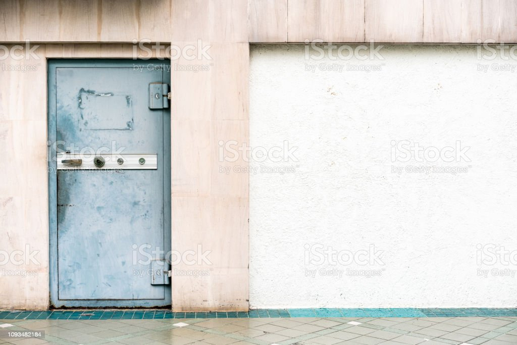 Old Steel Door With Safety Lock On The Left Side With White ...