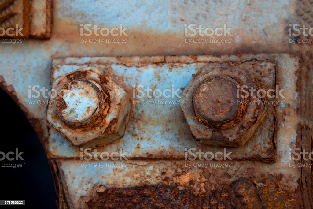 Old steel nut and rusty fixed steel pole royalty-free stock photo
