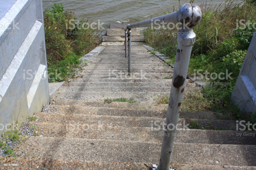 Old Steps Leading to River stock photo