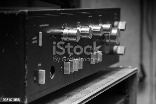istock Old stereo amplifier in black with silver handles 993101956