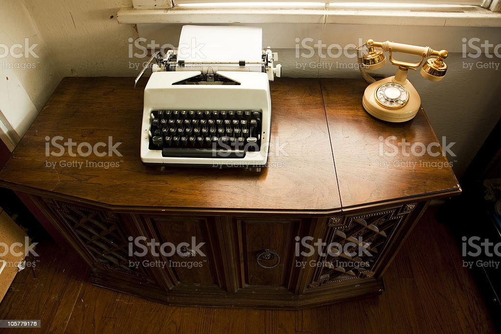 Old stereo console, typewriter and telephone royalty-free stock photo