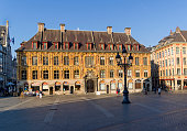 Lille, France - September 1, 2018:  View of the building of the old stock exchange (Vieille Bourse) from the theater square (Place du Theatre). Lille, France. Sunny day in early September.