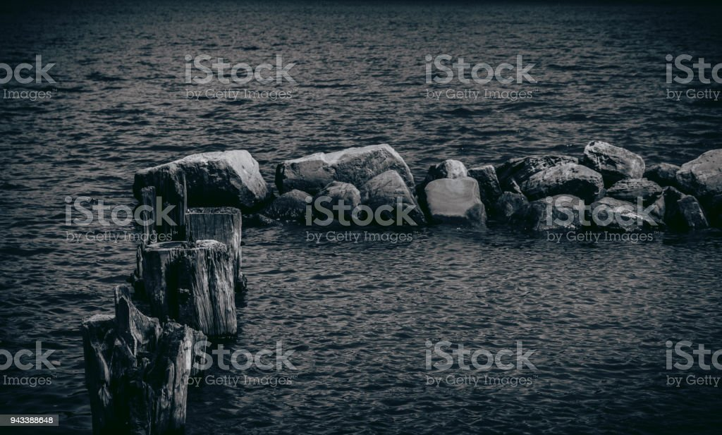 Old stone and wooden jetty stock photo