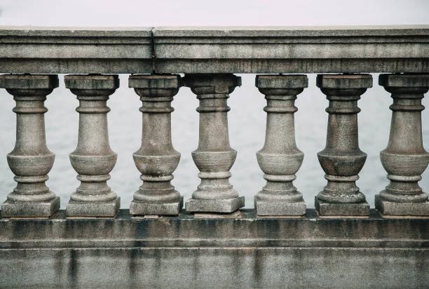 old stone balustrade of railing stock photo