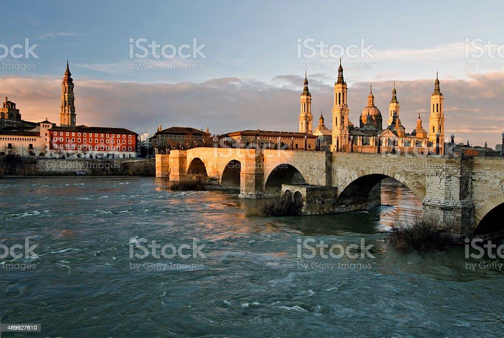 Old stone bridge across Ebro river in Zaragoza stock photo