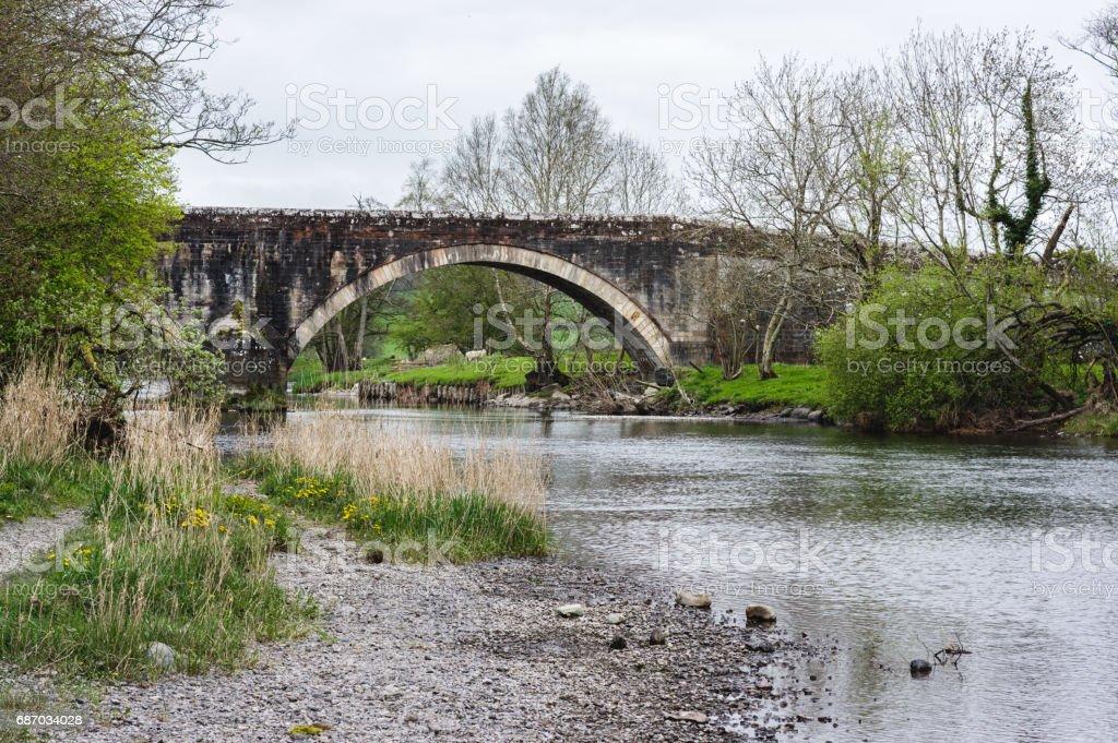 Old stone bridge in Lake District stock photo