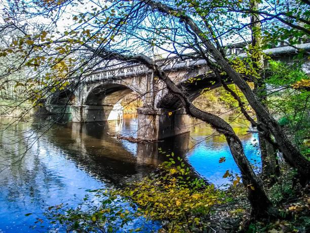 Old Stone Bridge on Buck Road over Neshaminy Creek, Bucks County, Pennsylvania stock photo