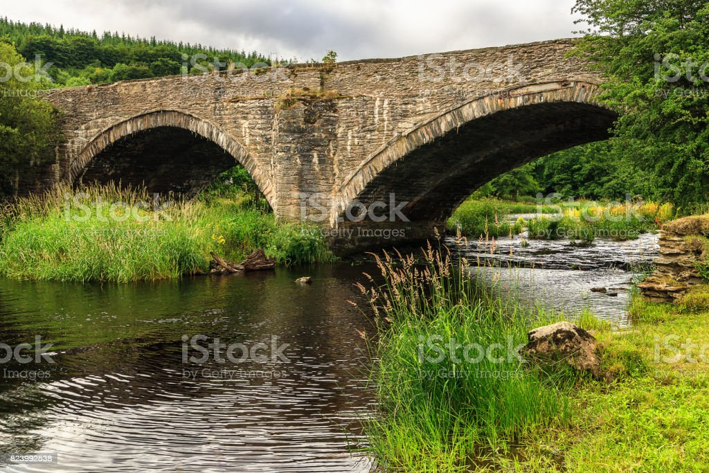 Old stone bridge over river Dee, Wales stock photo