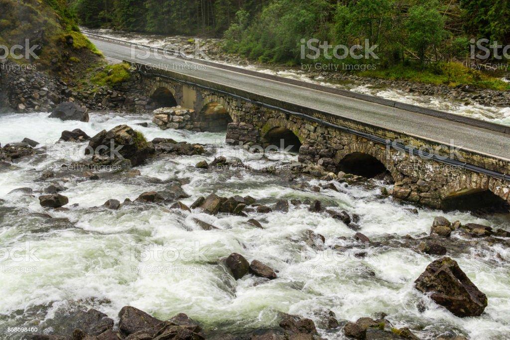 Old stone bridge. Road crossing river. Latefoss, Norway stock photo