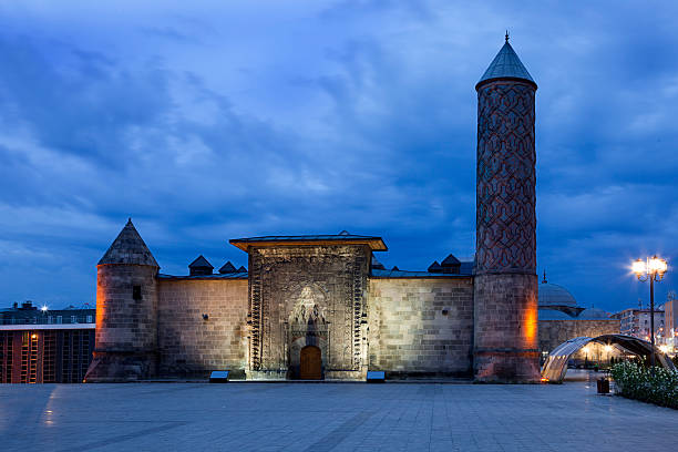 old stone building and tower of yakutiye medresse at night - erzurum stockfoto's en -beelden