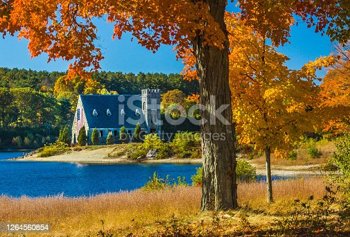 The abandoned Old Stone Church of West Boyleston, Massachusetts situated on the banks of the Wachusett Reservoir on a crisp October afternoon.