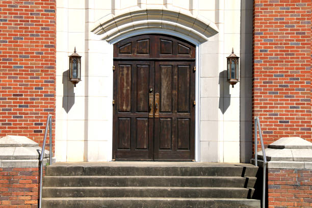 old stone church wood doors brick steps stock photo