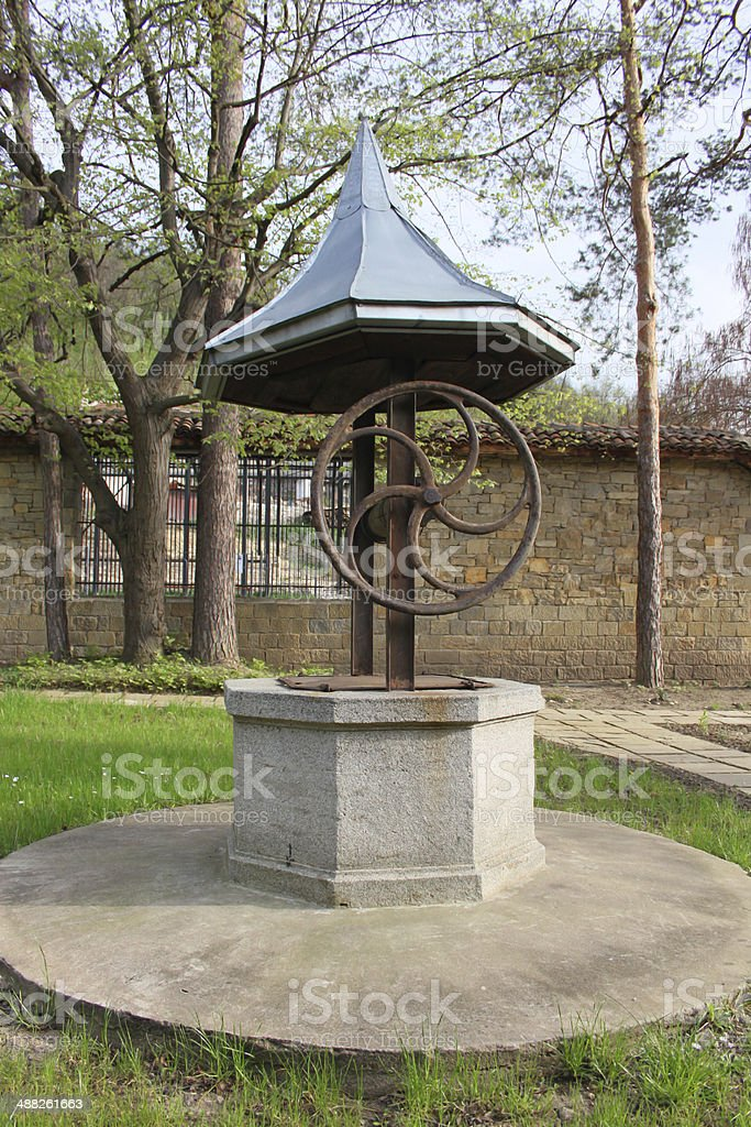 Old stone draw well stock photo