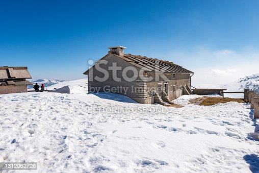 istock Old Stone Farmhouse and Cow Shed on Lessinia Plateau in Winter with Snow - Italy 1312062726