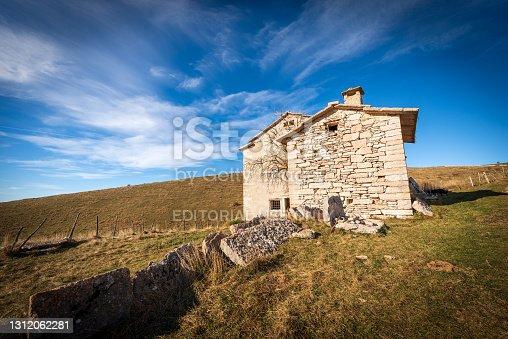 istock Old Stone Farmhouse on the Lessinia High Plateau - Verona Province Italy 1312062281
