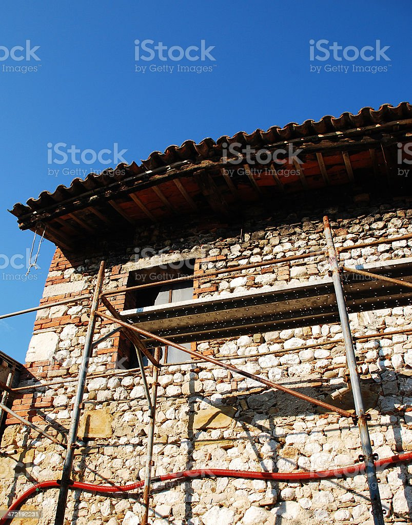 Old Stone Farmhouse With Scaffolding royalty-free stock photo