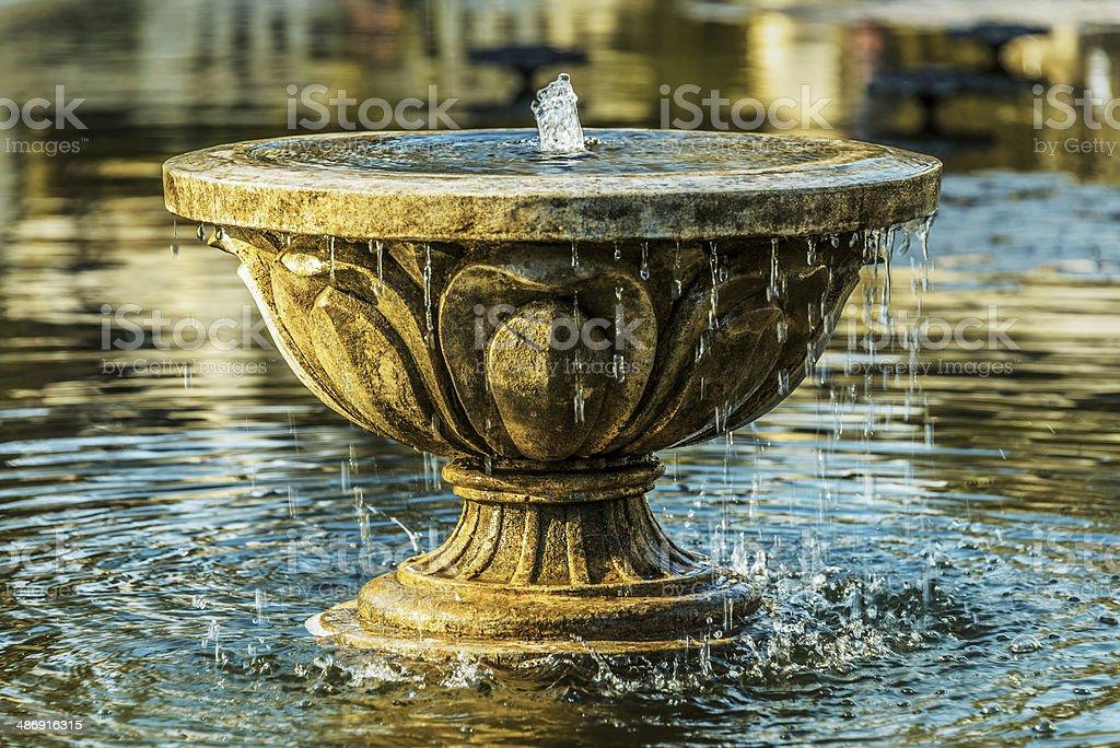 Old stone fountain stock photo