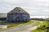 Stone hut with thatched roof--what the old settlers use to live in the early days of settling Nova Scotia.