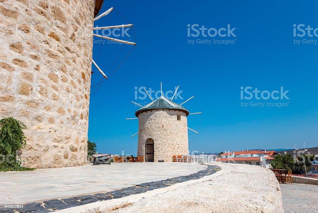 old stone mill in Alacati foto