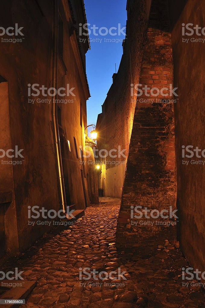 Old, stone street with lantern at dusk. Lublin in Poland. stock photo