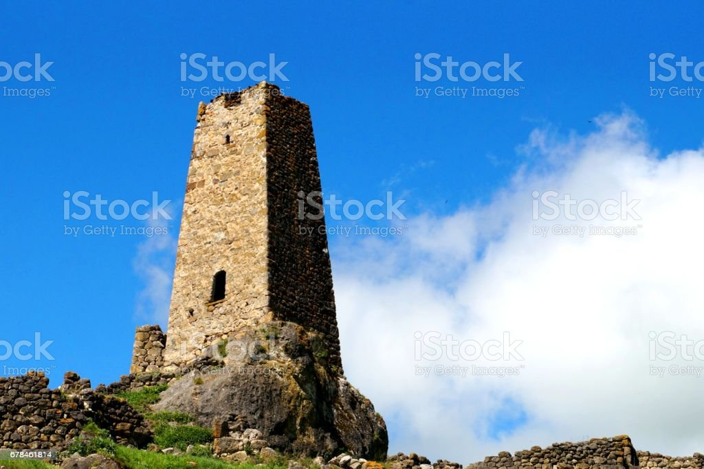 Old stone tower in the mountains royalty-free stock photo