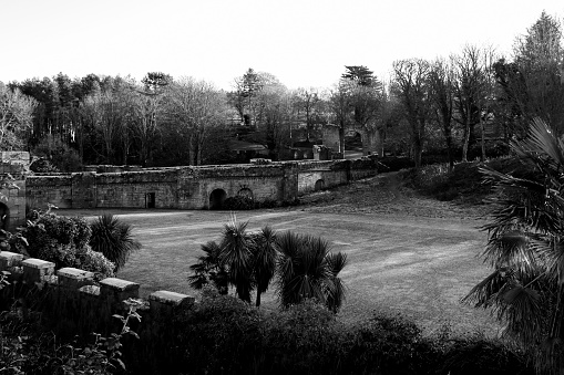 Old stone viaduct at a scottish castle on a winter morning monochrome
