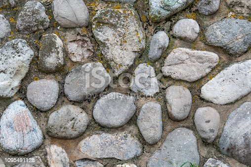 An old stone retaining wall made up of various size rocks and boulders held together with mortar. Nice background for architecture. Taken near Traverse City, Michigan.