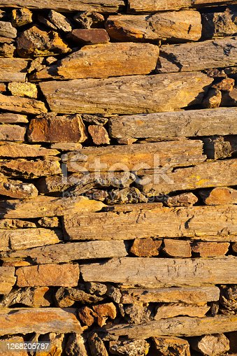 Full frame front vertical view of old stone wall , Ribeira Sacra area, Ourense province,Galicia, Spain. Copy space available.