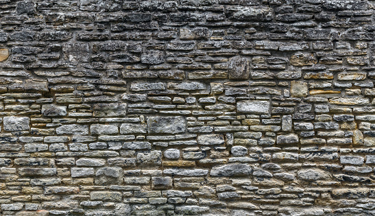 Old Stone Wall Background. Uneven Chaotic Stone Texture.