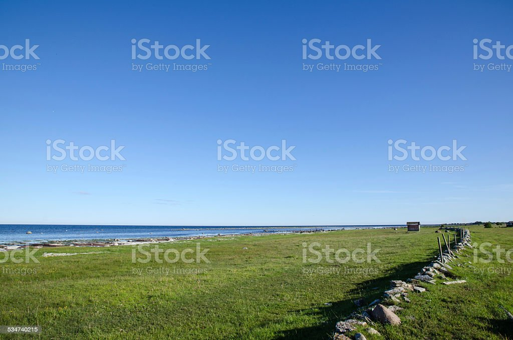 Old stone wall by the coast stock photo