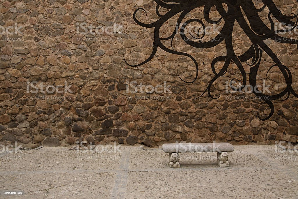 Old stone wall with bench and graffiti royalty-free stock photo