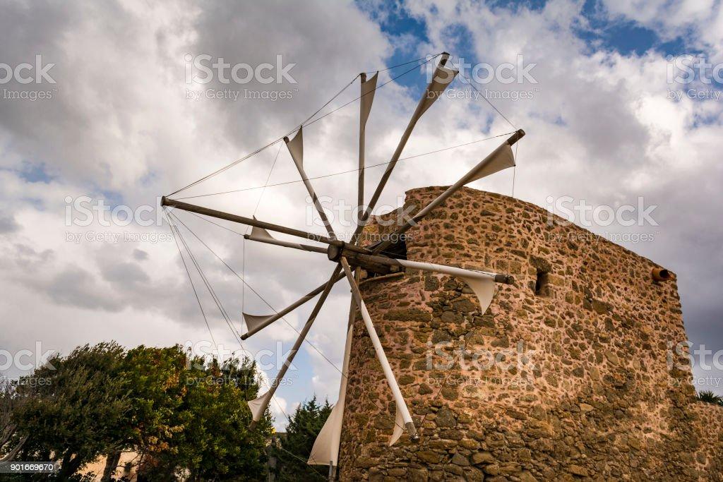 Old stone windmill near Toplou monastery in Crete, Greece stock photo