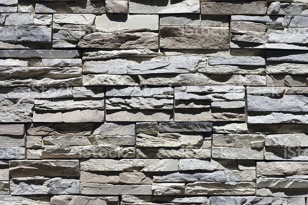old stony wall closeup in the sunshine royalty-free stock photo