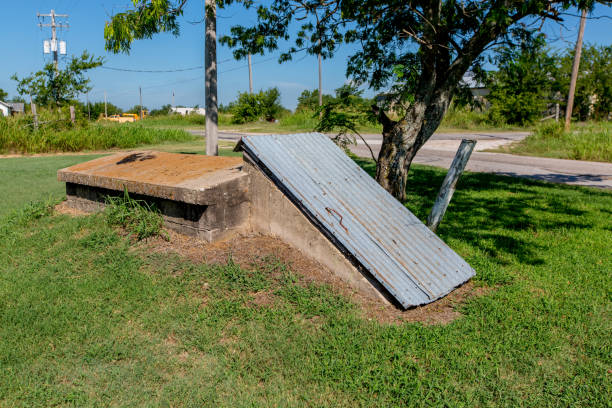 Old Storm Shelter. An Old Storm Cellar or Tornado Shelter in Rural Oklahoma. sheltering stock pictures, royalty-free photos & images