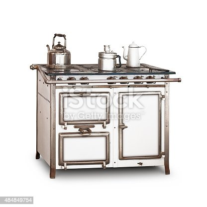Old gas stove with pot and kettle isolated on white background. Vintage kitchen. Single object with clipping path