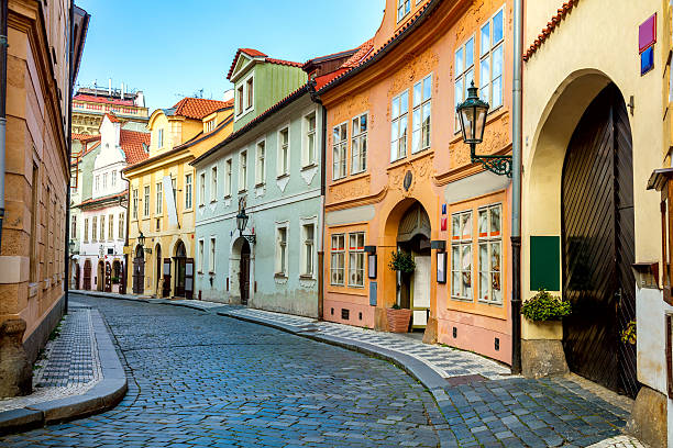 old street in prague at the morning, downtown - tsjechië stockfoto's en -beelden