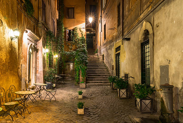 Old street in Rome, Italy Night view of old street in Rome, Italy courtyard stock pictures, royalty-free photos & images