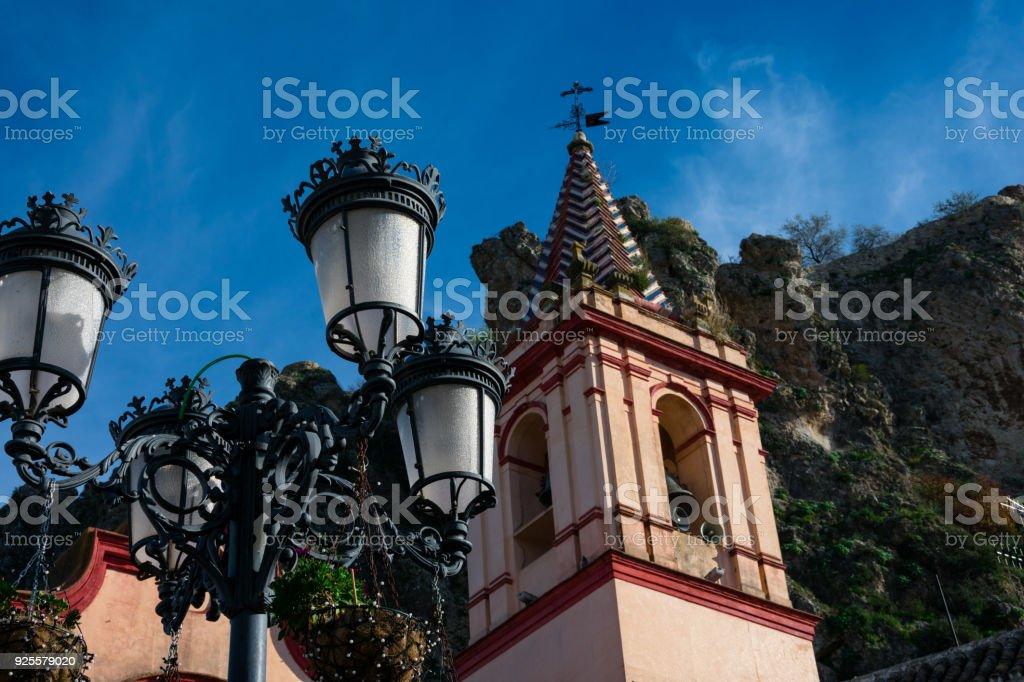 Old street lamp and Santa Maria de la Mesa church stock photo