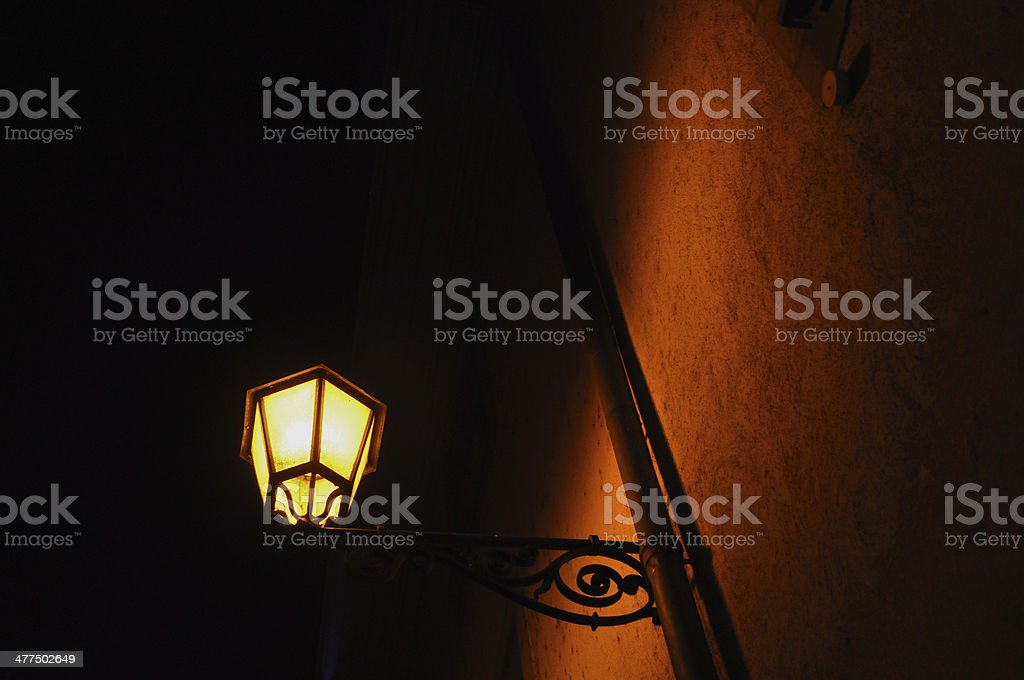 Old street lamp on stucco wall stock photo