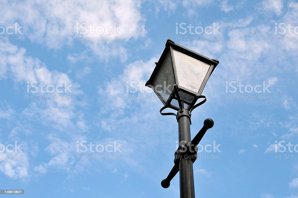 Old Street Light against a Blue Sky stock photo