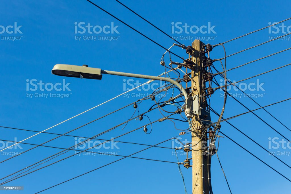 Old Street Light And Electric Pole On Blue Sky Background Royalty Free  Stock Photo