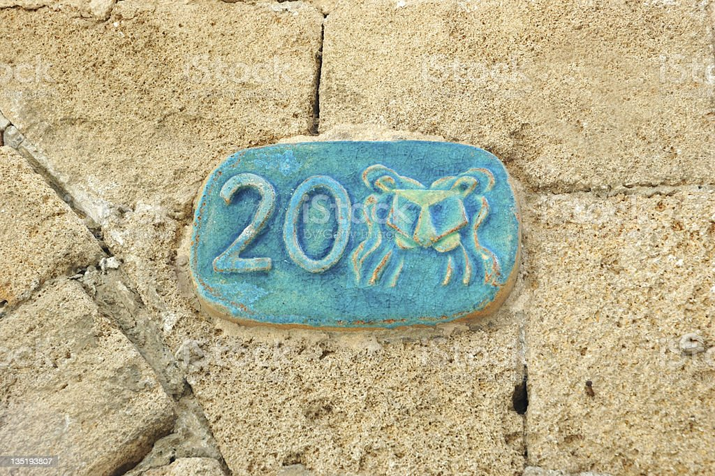 Old street plate with Lion zodiac sign, Jaffa, Israel royalty-free stock photo