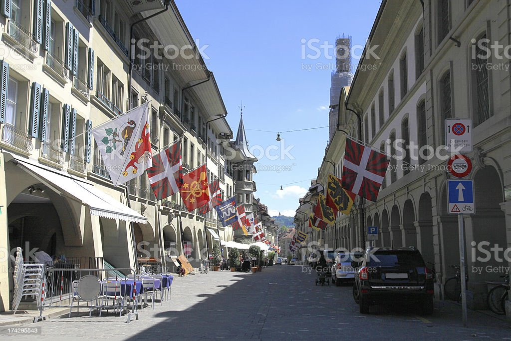 Old street with flags in Bern, Switzerland royalty-free stock photo
