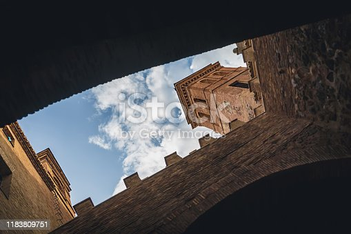 Old streets in Toledo against the blue sky, the bottom view.