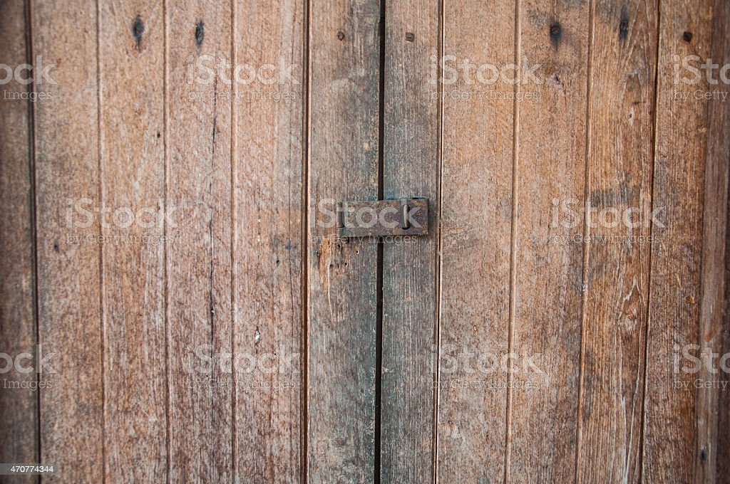 Old strong lock and cast iron latch locking  window stock photo