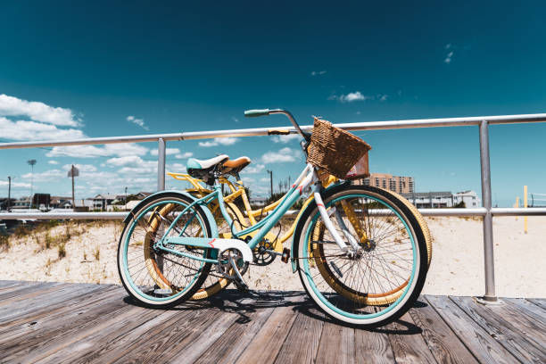 Old Style Bicycle on New Jersey Shore Boardwalk Vintage bikes on boardwalk boardwalk stock pictures, royalty-free photos & images