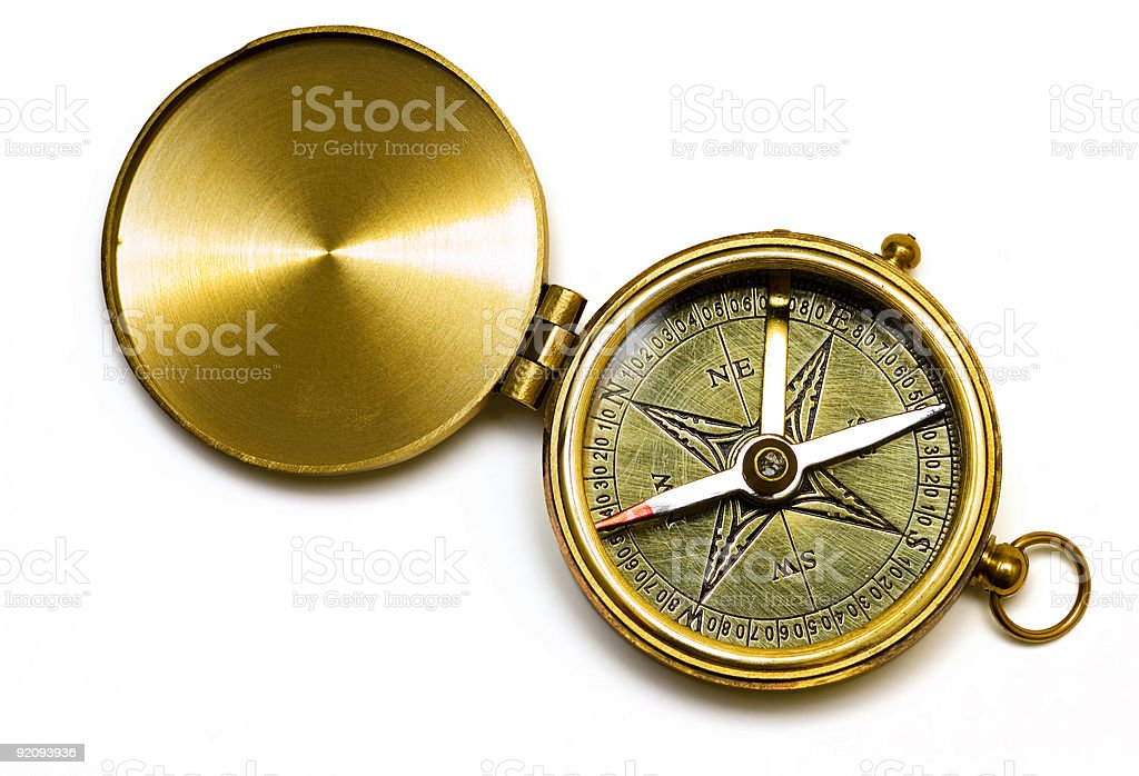 Old style brass compass on white background royalty-free stock photo