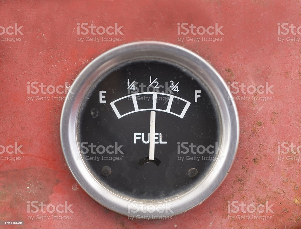 Old Style Car Fuel Gauge Showing Half Full stock photo